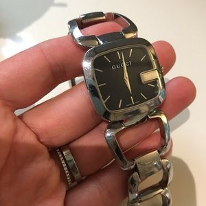 Gucci black dial silver tone link watch